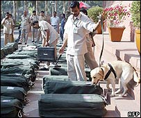 Sniffer dogs check the budget papers