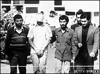 Blindfolded US hostage with Iranian student captor, 1979