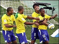 Ronaldo, Adriano, Kaka and Robinho celebrate a goal