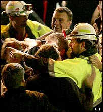 Todd Russell hugs family and friends outside the mine