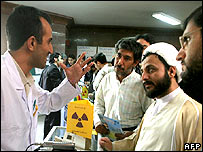 An Iranian technician discusses nuclear technology with clergymen