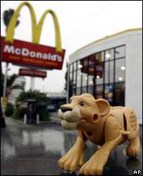 Happy Meal toy in front of a McDonalds outlet