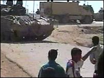 British armoured vehicle and Iraqis at Amara