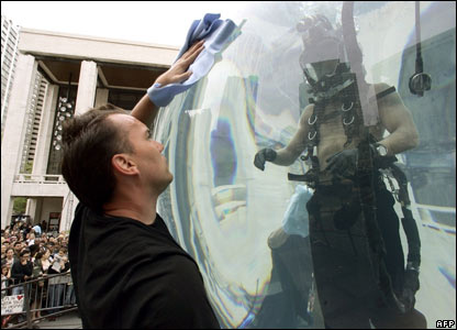 A cleaner polishes David Blaine's fish bowl