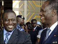 Rebel leader Guillaume Soro (l) and opposition leader Alassane Ouattara (r)
