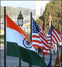 Indian and US flags near India Gate in Delhi