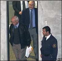 Col Jose Nino Gavazzo, centre top, leaves a court in Montevideo, Uruguay, Saturday