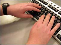 Man typing on computer keyboard