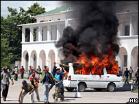Protesters set a van on fire on 28 April in the East Timorese capital, Dili