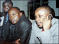 Standard editors Dennis Onyango (left) and Chaacha Mwita (right) and reporter Ayub Savula at the Central Police Station (Copyright: East African Standard)