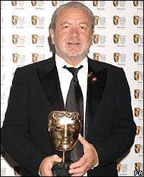 Sir Alan Sugar with The Apprentice's Bafta trophy