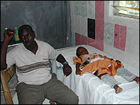 A patient lies in bed at the Hayat Hospital in Mogadishu