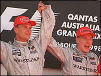 Mika Hakkinen (right) raises David Coulthard's arm on the rostrum after the 1998 Australian Grand Prix, during which Coulthard was told to move over and hand victory to the Finn