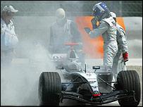 David Coulthard stands next to his stricken McLaren in Bahrain in 2004