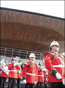 A military brass band entertained gathering crowds outside the Senedd
