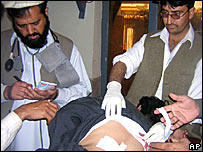 Doctors treat an injured person at a local hospital in Miran Shah
