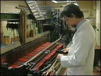 Textile worker making tartan