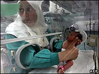 A nurse attends a newborn baby at Shifa Hospital