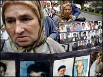 Bosnian Muslim protester with photos of missing