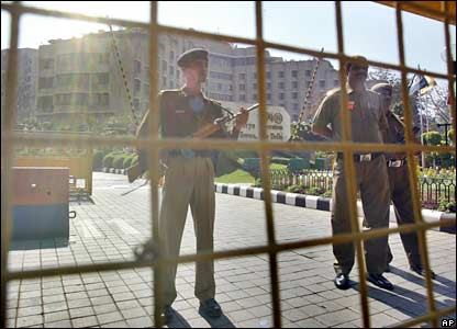 Indian security personnel stand guard at the entrance of the Maurya Sheraton Hotel in Delhi