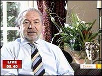 Sir Alan Sugar with the BAFTA he's just won for The Apprentice