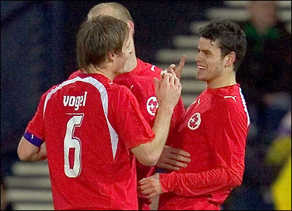 Tranquillo Barnetta is congratulated by captain Johann Vogel