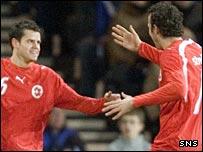 Tranquillo Barnetta (left) celebrates his goal