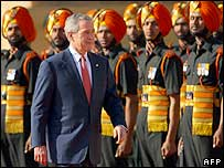 President Bush inspects a guard of honour at the presidential palace
