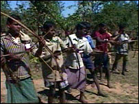 Maoist rebels training with bows and arrows