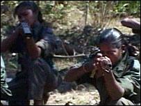 Female rebels holding guns