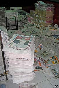 Scattered newspapers after the police raid