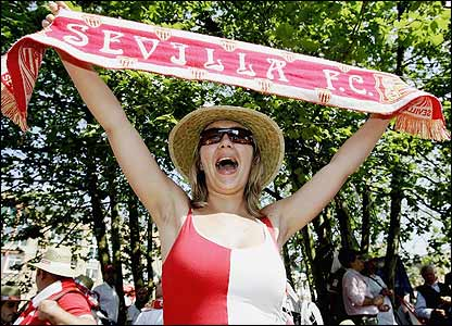A Sevilla fan enjoys the atmosphere ahead of kick-off