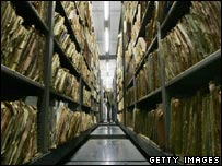A visitor to the Stasi archives walks through the files department in Berlin