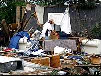 Local resident Dennis Lea assesses the damage to his home in Westminster