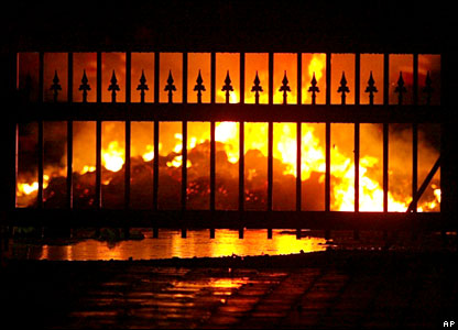 The fire seen through the office gates
