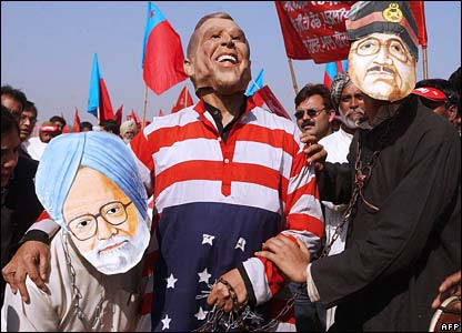 Protesters in Delhi with caricatures of Indian pm Singh (l), President Bush (c) and Pakistani president Musharraf (r)