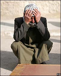 Man crying outside Baghdad mortuary