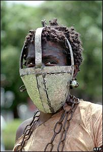 Actress wears mask used to stop slaves eating sugar cane on Guadeloupe (archive image)