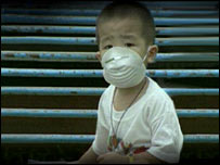 Malaysian child wearing smog mask.  Image: BBC