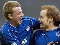 Martin Bavidge (right) celebrates his winner for Peterhead