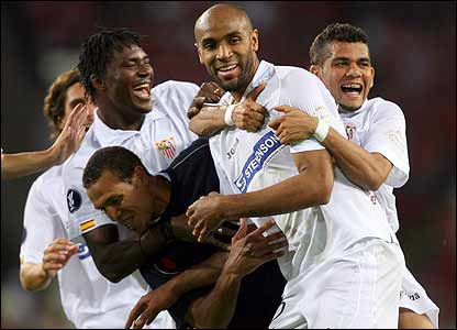 Fredi Kanoute is congratulated after scoring Sevilla's fourth