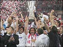 Sevilla players raise the Uefa Cup