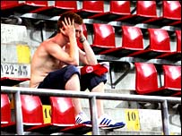 A lone Middlesbrough fan sits in the Philips Stadion