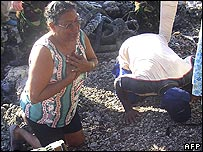 Chagos islanders kiss the soil of Solomon island on a visit last April