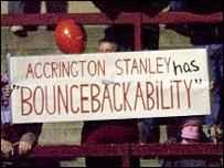 "Accrington fans disaplay a ""Bouncebackabillity"" sign"