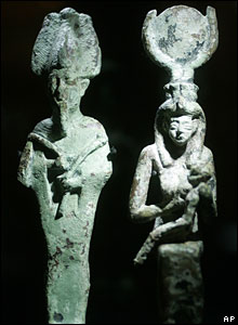 Sculptures of Egyptian god and goddess Osiris and Isis at the Egypt's Sunken Treasures exhibition in Berlin