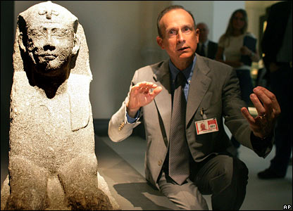 French underwater archaeologist Franck Goddio beside a Sphinx statue