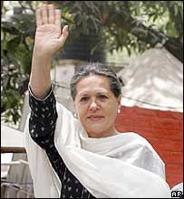 Sonia Gandhi waves to supporters after her victory