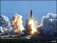 Space shuttle Discovery taking off