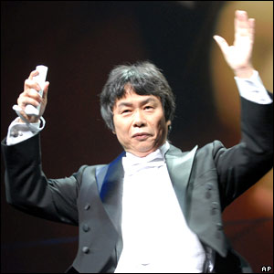 Nintendo's Shigeru Miyamoto conducts an orchestra with the Wii controller